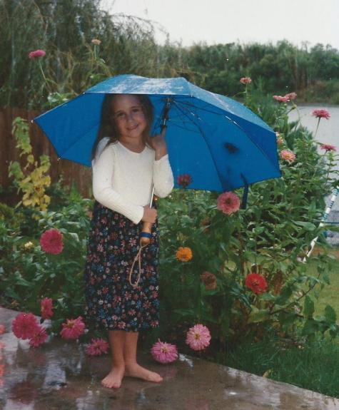 Jillian Playing in the Rain and Zinnias